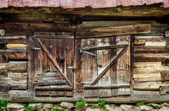 Detail of old wooden textured and weathered barn door. Vlkolinec village, Slovakia Stock Images