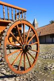 Wooden wheel of a carriage in the courtyard of the hacienda Stock Image