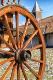 Detail of an old wooden wheel in the yard Stock Photography