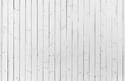 Detail of old wooden white colored wall with a lot of cracks and limbs, textured background Royalty Free Stock Photography