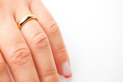 Detail of one hand with gold ring with space for text Stock Image