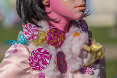 Detail of one living statue of a woman multicolor dressed Stock Photography