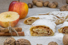 Detail on a One Slice Sugared Homemade Apple Strudel on a Baking. Detail on a One Slice Sugared Homemade Apple Strudel on Baking Paper stock image