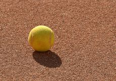 Detail of one tennis ball on the clay tennis field. Photography stock photos