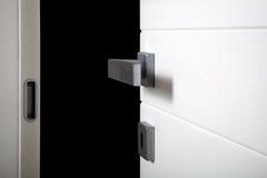 Detail open door on black. Open white door on black background royalty free stock photo