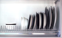 Detail of open kitchen drawers with dishes Royalty Free Stock Photo