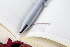 Detail of an open red diary with pen Stock Images