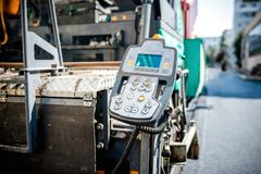 Detail of operating and command center on paving machine. Detail of operating and command center on industrial asphalting paver Royalty Free Stock Image
