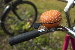 Detail of an orange bicycle ring bell Stock Photography