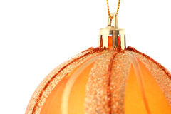Detail of orange Christmas bauble isolate on white Royalty Free Stock Image