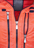 Detail of orange jacket with zipper Royalty Free Stock Photo