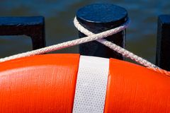 Detail of the orange live saving ring hanging on a Stock Photo