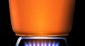 Detail of orange pot on the stove flame Royalty Free Stock Photo