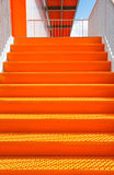 Detail of orange steel stairway. On the outside of a building Stock Images