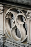 Detail of Ornate Stone Railing. A sculpted railing provides detail on the balcony of an historic building royalty free stock photo