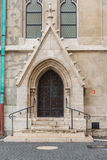 Detail of an ornate Victorian brick archway and wooden door a church. stock image