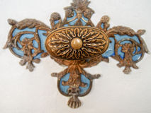 Detail of Ornate Vintage Doorknob. Detail of a decorative doorknob with blue and copper color Stock Photography