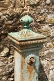 Detail of an ornate vintage water pump. In the small Tuscan village of Benabbio, Italy stock photos