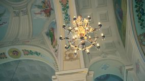 Detail of of the Orthodox Church. Bright dome and chandelier stock video footage