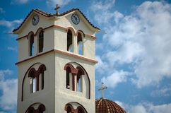 Detail of orthodox church with clock. And clouds and blue sky Stock Images