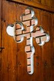 Orthodox cross as ornament on church door. Detail of orthodox cross as ornament on church wooden door Stock Photography
