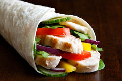 Detail os grilled chicken and salad tortilla wrap on dark backgr Royalty Free Stock Image