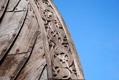 Detail of Oseberg viking ship replica. The Oseberg ship (Norwegian: Osebergskipet) is a Viking ship discovered in a large burial mound at the Oseberg farm near T Royalty Free Stock Photo