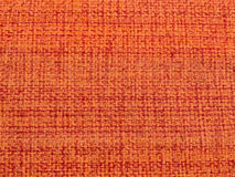 Detail of Padroes of red orange fabric. Close up Detail of patterns of rude, orange-red fabric Royalty Free Stock Photography