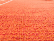 Detail of Padroes of red orange fabric. Close up Detail of patterns of rude, orange-red fabric Royalty Free Stock Photos