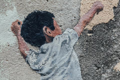 Detail of Painted Children Play Basketball on The Concrete Wall fro The Street of George Town. Penang, Malaysia Stock Photo
