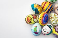 Detail of painted Easter eggs with different forms, cartoons and bright colors on white background.  royalty free stock photo