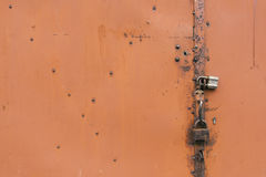 Detail of the painted metal door with old padlocks, closeup. Detail of the painted metal surface with old padlocks, background Stock Photography