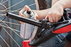Detail painting. Hand paint with a cylinder of black paint, a bicycle detail Stock Images