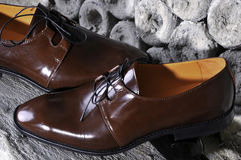 Detail of a pair of brown luxurious men's leather shoes. Royalty Free Stock Photos