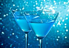 Detail of a pair of glasses of blue cocktail on table Royalty Free Stock Image