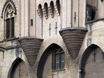 Detail of the Palais des Papes, Avignon, France. Palais des Papes  (The Pope's Palace) in Avignon ( France) - unesco world heritage site; Towers above entrance Royalty Free Stock Image