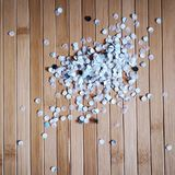 Paper confetti from hole puncher. Detail of paper confetti from hole puncher Royalty Free Stock Photography