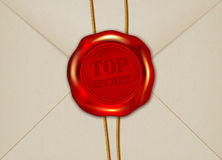 Detail of paper envelope with TOP SECRET wax seal Royalty Free Stock Photo