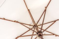 Beige sun umbrella as background royalty free stock photography