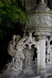 Detail in the park - old stone statue of heron, Quinta da Regaleira Palace in Sintra, , Portugal. Detail in the park - old stone statue of heron, Quinta da Stock Images