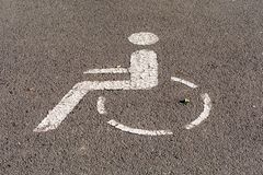 Marker for a disabled parking space on the asphalt stock photo