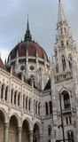Detail of Parliament Budapest. Detail bottom view of dome and tower of Parliament building in Budapest Royalty Free Stock Photos