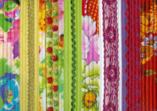 Detail of patchwork fabric handmade. With machine quilting. Decorated with braid and lace Royalty Free Stock Photography