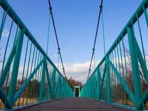 Detail of a pedestrian suspension bridge across the river Kovash in Sosnovy Bor Stock Photos