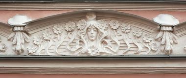 Detail of pediment building in Art Nouveau style Stock Photos