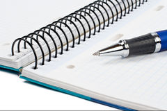 Detail of pen and blank notebook sheet Stock Photo