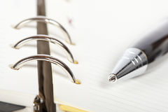 Detail of pen and opened agenda Stock Photography
