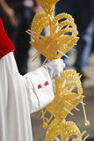 Detail penitent  holding a palm during Holy Week on Palm sunday Royalty Free Stock Photography