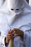 Detail penitent white holding a candle during Holy Week Stock Images