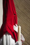 Detail penitent white holding a candle during Holy Week Royalty Free Stock Images